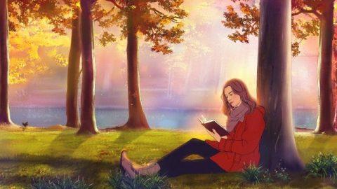 Una cristiana legge un libro sotto l'albero
