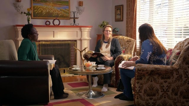 Tre cristiani alla riunione